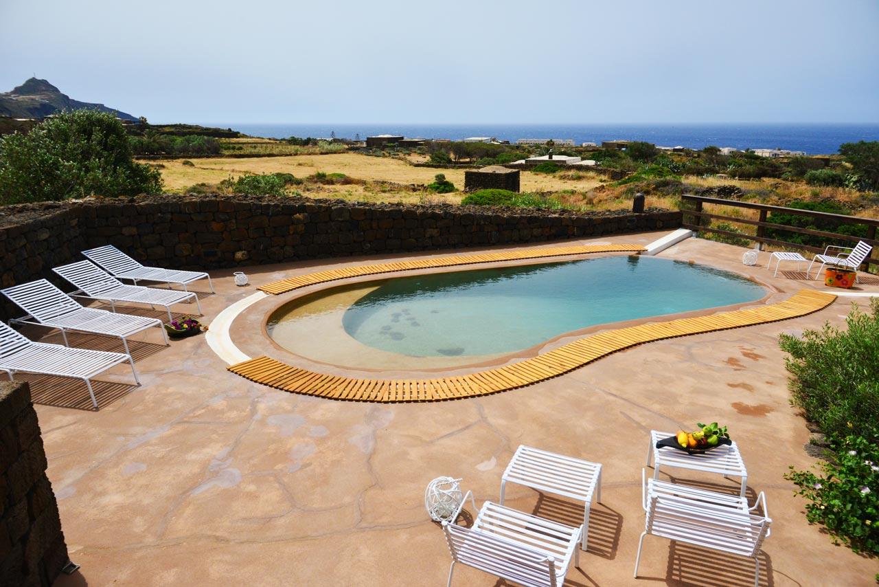 dammuso-stellato,-esterno,-piscina--esterno---sdraio--immobiliare-pantelleria - Copia